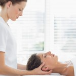 A woman being treated for neck pain and headaches