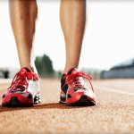 Athletes lower leg in runners standing on a running track
