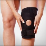 A brace on a patients knee after suffering a meniscus injury
