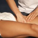 woman giving massage to a persons legs