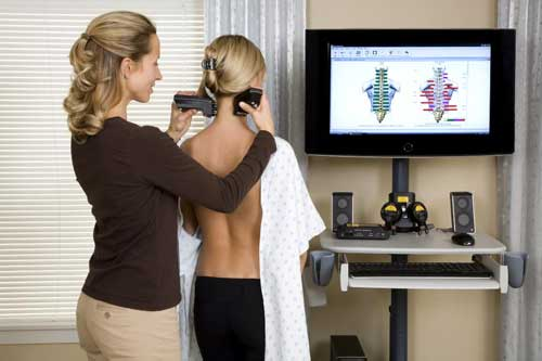 Osteopath Therapist conducting a spinal scan on patient